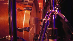 Drummer plays on a bass drum with pedal. Drummer plays on a bass drum set with pedal on the stage. Jazz or rock concert performance entertainment. Close up shot stock video footage