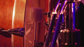 Drummer plays on a bass drum with pedal. Drummer plays on a bass drum set with pedal on the stage. Jazz or rock concert performance entertainment. Close up shot stock footage