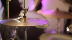 The drummer plays the cymbals at a concert. The drummer hits the plate drum. stock video footage