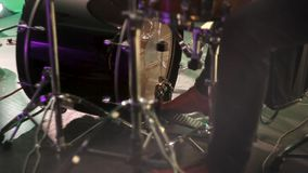 Drummer plays the drum by kicking the pedal. The drummer`s foot moves the drum bass pedal. stock video footage