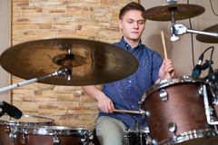 Drummer plays the drum kit in the studio Royalty Free Stock Image