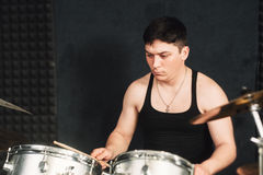 Drummer plays on drum set closeup Royalty Free Stock Photos