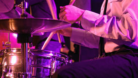 Drummer plays on drum set and cymbal Stock Image