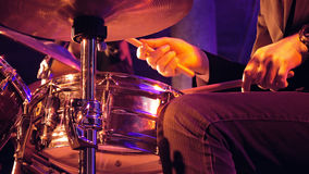 Drummer plays on drum set and cymbal Royalty Free Stock Image