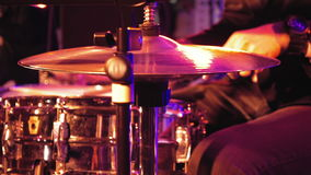 Drummer plays on drum set and cymbal stock footage