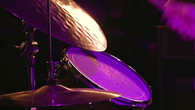 Drummer plays on drum set and cymbal. With drumsticks on the stage. Jazz or rock concert performance entertainment. Close up shot with soft selective focus stock footage