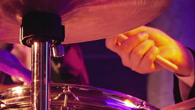 Drummer plays on drum set and cymbal. With drumsticks on the stage. Jazz or rock concert performance entertainment. Close up shot with soft selective focus stock video