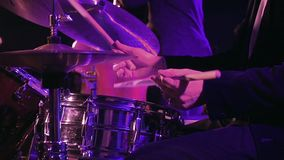 Drummer plays on drum set and cymbal slow motion. Drummer plays on drum set and cymbal with drumsticks on the stage. Jazz or rock concert performance stock video