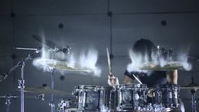Drummer plays the drums in a hangar. Slow motion. Smoke background stock video