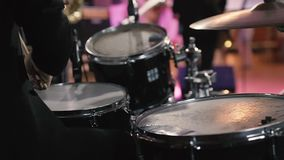Drummer Plays Drums Kit. Drummer Hand Silhouette With Drumstick. Close up of Drummer Hand Playing Drum Plate on Rock Concert. Rock Band Performing on Stage stock footage