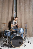 Drummer plays drums in room Stock Photo