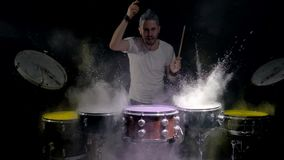 Drummer plays with drumsticks musical drum of colourful lights stock video