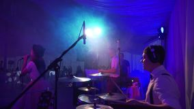 Drummer plays the melody on the drums energetically. stock footage