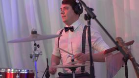 Drummer plays the melody on the drums energetically. stock video footage