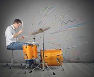 Drummer producing notes Royalty Free Stock Image