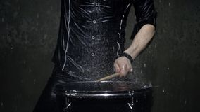 Drummer in the rain close up stock footage