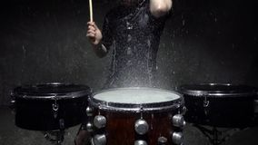 Drummer in the rain close up slow motion stock video footage