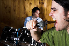 Drummer and rock singer Royalty Free Stock Photography