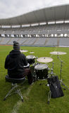 Drummer at the Stadium. Empty Olympic Stadium and a drummer playing Stock Photo