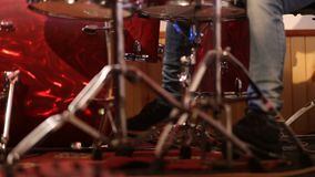 Drummer on stage playing kick drum stock footage