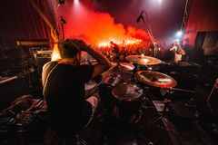Drummer on stage. silhouette of music band in action on music stage. popular music rock band performs on stage royalty free stock image