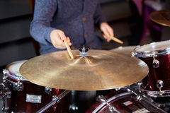 Drummer striking cymbal with drumstick Royalty Free Stock Image