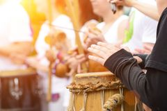 Drummer with traditional Brazilian Drum and drum sticks in rays. Of the sun, selective focus royalty free stock photography