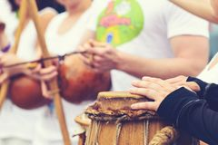 Drummer with traditional Brazilian Drum and drum sticks, selecti. Ve focus, toned image stock photo