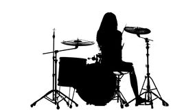 Drummer vigorously plays the drums, her wand. White background. Silhouette