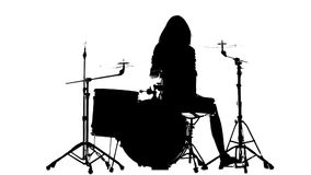 Drummer vigorously plays the drums, her wand. White background. Silhouette. Slow motion stock video footage