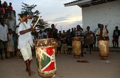 Drummers in Burundi. A group of people playing the drums with onlookers in the background Royalty Free Stock Image