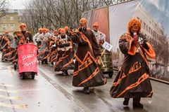 Drummers group marching  under rain at Carnival parade, Stuttgart Stock Photo