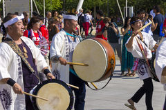 Drummers and musicians in white dresses on the Japanese traditional parade on EXPO 2015 Royalty Free Stock Images