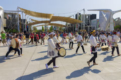 Drummers and musicians in white dresses on the Japanese traditional parade on EXPO 2015 Stock Photography