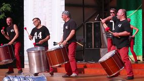 Drummers on open air stage. PERM, RUSSIA - JUN 5, 2015: Drummers on open air stage. 44 DRUMS group drummers there are more than five years stock footage