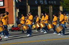 Drummers in Parade. LA Korea Festival Orange Marching Drummers Koreatown 2015 Royalty Free Stock Photos