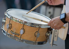 Drummers playing snare drums in parade. Drummer in a Marching Band. Drummers playing snare drums in parade Stock Image