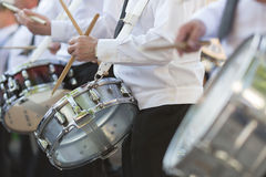 Drummers playing snare drums in parade Royalty Free Stock Image