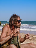 Drumming on the beach. Man drum on tam-tam on the beach Stock Photography
