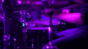 Drumming in colored lights. metal concert. colorfull stock video