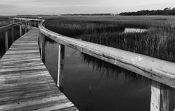 Drummond Point Park Amelia Island. A seemingly endless raised Boardwalk extending into the coastal marshland of Drummond  Point Park Amelia Island Florida Royalty Free Stock Photos