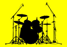 Drums. Silhouettes of drums on a yellow background Stock Photo