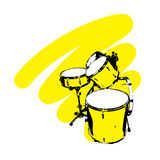 Drums. On a yellow background Stock Images