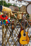 Drums and acoustic Guitars. Drums, acoustic Guitars, and basketry in a fair shop Stock Photos