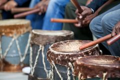 Drums being hit with sticks. royalty free stock photography