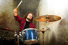 Drums conceptual image. Rock drummer and his drum set. Royalty Free Stock Photography