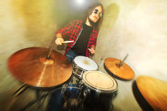 Drums conceptual image. Rock drummer and his drum set. Royalty Free Stock Images