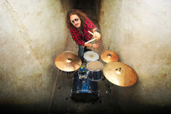 Drums conceptual image. Rock drummer and his drum set. Stock Photo