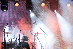 The drums in concert. A drum kit, drum set or trap set is a collection of drums and other percussion instruments set up to be played/struck by a single player Stock Image