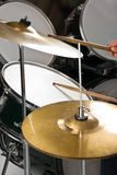 Drums and cymbal. Human hand holding drumsticks playing drums and cymbal,check also Musical instruments and musicians Stock Photo